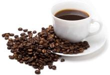 ถ้วยกาแฟและเมล็ดกาแฟ