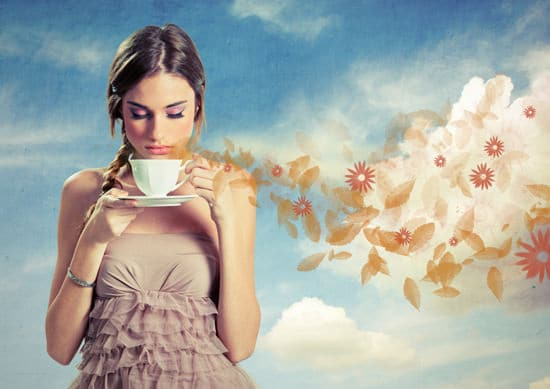 Girl Smelling Cup of Coffee