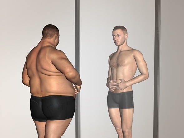 ชายอ้วนมองภาพตัวเองในกระจก