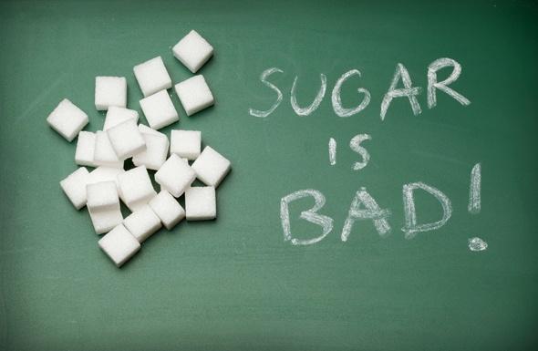 น้ำตาลไม่ดีเขียนบนกระดานดำ