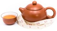 กาน้ำชาถ้วยน้ำชาและตลับเมตร